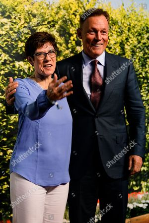 Vice-President of the Bundestag Thomas Oppermann (R) (SPD) and CDU Secretary General Annegret Kramp-Karrenbauer (L) attend the 'BILD100 summer party' event in Berlin, Germany, 12 September 2018. 100 of the most important decision-makers from politics and business as well as well-known personalities from sports, art and culture are expected at the event held by Germany's highest-circulation newspaper BILD.