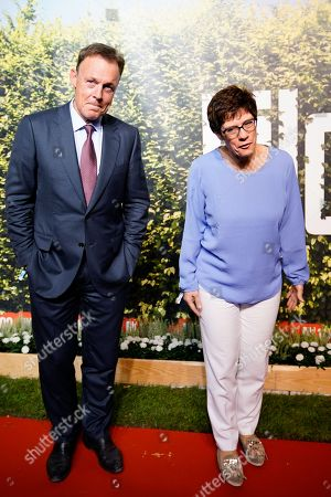 Vice-President of the Bundestag Thomas Oppermann (L) (SPD) and CDU Secretary General Annegret Kramp-Karrenbauer (R) attend the 'BILD100 summer party' event in Berlin, Germany, 12 September 2018. 100 of the most important decision-makers from politics and business as well as well-known personalities from sports, art and culture are expected at the event held by Germany's highest-circulation newspaper BILD.