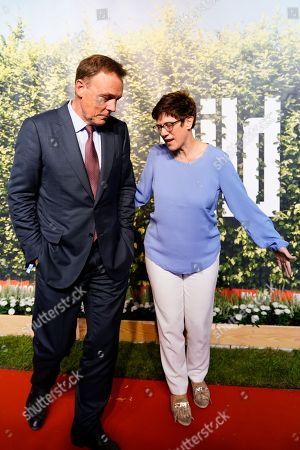 Stock Photo of Vice-President of the Bundestag Thomas Oppermann (L) (SPD) and CDU Secretary General Annegret Kramp-Karrenbauer (R) attend the 'BILD100 summer party' event in Berlin, Germany, 12 September 2018. 100 of the most important decision-makers from politics and business as well as well-known personalities from sports, art and culture are expected at the event held by Germany's highest-circulation newspaper BILD.