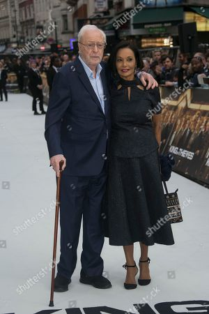 Sir Michael Caine, Shakira Caine pose for photographers upon arrival for the World Premiere of the film 'The Escape', at a central London cinema