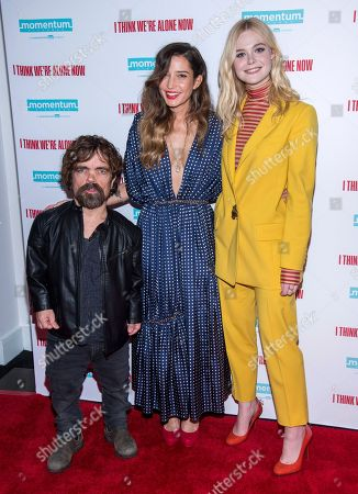 """Peter Dinklage, Elle Fanning, Reed Morano. Peter Dinklage, left, Reed Morano and Elle Fanning attend a screening of """"I Think We're Alone Now"""" at Dolby 88, in New York"""