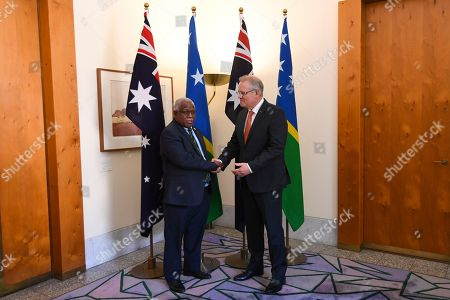 Stock Image of Australian Prime Minister Scott Morrison (R) shakes hands with Prime Minister of Solomon Islands Rick Houenipwela (L) during a bilateral meeting at Parliament House in Canberra, Australia, 13 September 2018.
