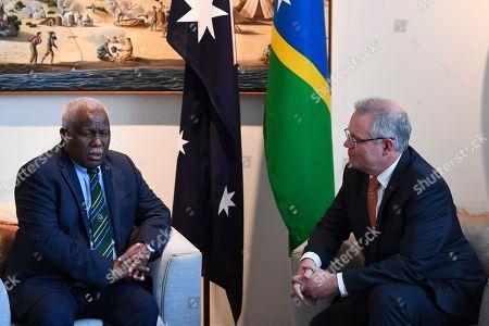 Australian Prime Minister Scott Morrison (R) speaks with Prime Minister of Solomon Islands Rick Houenipwela (L) during a bilateral meeting at Parliament House in Canberra, Australia, 13 September 2018.