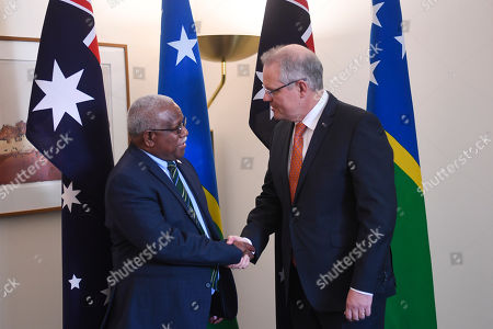 Stock Photo of Australian Prime Minister Scott Morrison (R) shakes hands with Prime Minister of Solomon Islands Rick Houenipwela (L) during a bilateral meeting at Parliament House in Canberra, Australia, 13 September 2018.