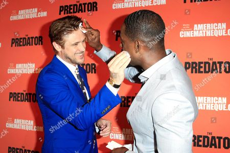 Stock Image of US actors/cast members Boyd Holbrook (L) and Sterling K Brown powder each others faces at the screening of 20th Century Fox's 'The Predator,' at the Egyptian Theatre in Los Angeles California, USA, 12 September 2018. The film opens in the US 9 February 2018.