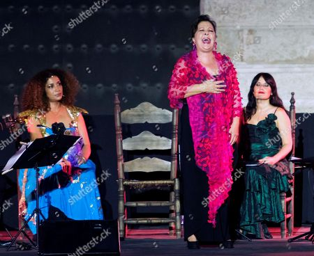 Spanish flamenco singer Carmen Linares (C), Tunisian singer Ghalia Benali (L) and Spanish soprano Marivi Blasco perform on the stage during the show 'Romances entre Oriente y Occidente' (Romance between the East and the West) at the Alcazar of Seville as part of the Flamenco Biennial 2018, in Seville, southern Spain, 12 September 2018 (issued 13 September 2018). The flamenco event runs from 06 to 30 September.
