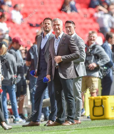 Television pundits and former players Jamie Redknapp , Graeme Souness  and Robbie Keane at the Premier League match between Tottenham Hotspur and Liverpool at Wembley Stadium , London , 15 Sept 2018