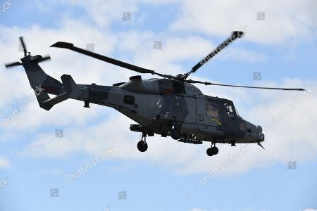 Prince Harry arrives at the Centre in a Royal Navy Wildcat Maritime Attack Helicopter drawn from the Commando Helicopter Force
