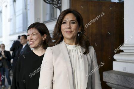 Stock Photo of Crown Princess Mary of Denmark and Deputy Mayor of Helsinki Anni Sinnemaki (r) pose before attendsing the Urban Solutions seminar at the Helsinki City Hall