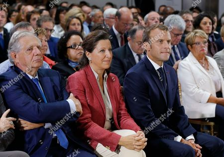 From left to right, Minister of Territorial Cohesion Jacques Mezard, Minster of Solidarity and Health Agnes Buzyn and French President Emmanuel Macron attend an event on poverty in Paris, France