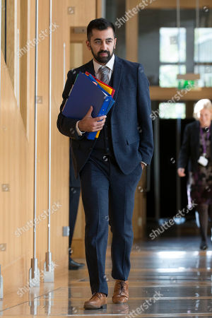 Humza Yousaf, Cabinet Secretary for Justice, makes his way to the Debating Chamber.