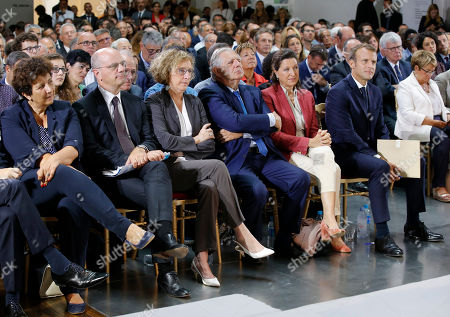 (L-R), Minister for Higher Education Research and Innovation Frederique Vidal, Minister of Education Jean-Michel Blanquer, Labor Minister Muriel Penicaud, Minister of Territorial Cohesion Jacques Mezard, Minster of Solidarity and Health Agnes Buzyn and French President Emmanuel Macron attend an event on poverty in Paris, France, 13 September 2018. French President Emmanuel Macron has unveiled a 8-billion euro plan focusing on education and getting the unemployed back to work in an effort to combat poverty. The inscriptions on the wall reads 'make more for those who have less'.