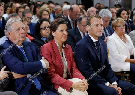 (L-R), Minister of Territorial Cohesion Jacques Mezard, Minster of Solidarity and Health Agnes Buzyn and French President Emmanuel Macron attend an event on poverty in Paris, France, 13 September 2018. French President Emmanuel Macron has unveiled a 8-billion euro plan focusing on education and getting the unemployed back to work in an effort to combat poverty. The inscriptions on the wall reads 'make more for those who have less'.