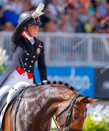 Charlotte Dujardin of Great Britain reacts after competing aboard Mount St John Freestyle during the team championship Grand Prix de Dressage at the FEI World Equestrian Games 2018 at the Tryon International Equestrian Center in Mill Spring, North Carolina, USA, 13 September 2018. Great Britain won the team bronze medal in the event. The World Equestrian Games continue through 23 September 2018.