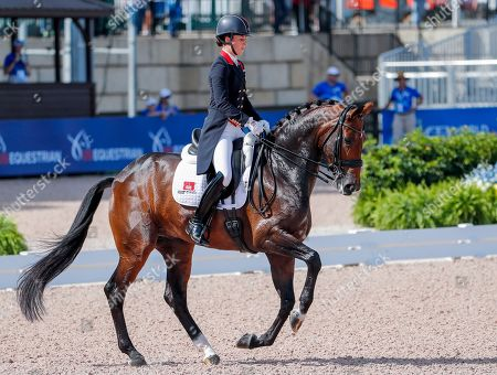 Charlotte Dujardin of Great Britain competes aboard Mount St John Freestyle during the team championship Grand Prix de Dressage at the FEI World Equestrian Games 2018 at the Tryon International Equestrian Center in Mill Spring, North Carolina, USA, 13 September 2018. Great Britain won the team bronze medal in the event. The World Equestrian Games continue through 23 September 2018.