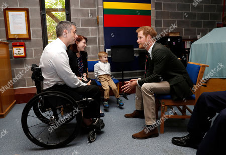 Prince Harry speaks with Matt Drake (R) who suffered injury in the Middle East and is now supported by The Royal Marines Charity during his visit The Royal Marines Commando Training Centre