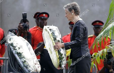 Nane Annan, widow of former U.N. Secretary-General Kofi Annan, lays a wreath during the funeral of her husband, at a cemetery in Accra, Ghana . Former United Nations Secretary-General Kofi Annan was buried Thursday after a three-day funeral and ceremony