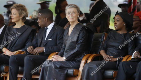 From left to right, Kofi Annan's daughter Nina Cronstedt, son Kojo Annan, widow Nane Annan, and daughter Ama Annan, during the funeral of former U.N. Secretary-General Kofi Annan, at a cemetery in Accra, Ghana . Former United Nations Secretary-General Kofi Annan was buried Thursday after a three-day funeral and ceremony