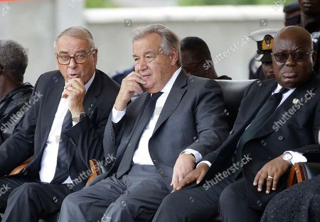 Adolf Ogi, Former President of the Swiss Confederation, left, current U.N. Secretary-General Antonio Guterres, center, and Ghana's President Nana Addo Dankwa Akufo-Addo, right, during the funeral of former U.N. Secretary-General Kofi Annan, at a cemetery in Accra, Ghana . Former United Nations Secretary-General Kofi Annan was buried Thursday after a three-day funeral and ceremony