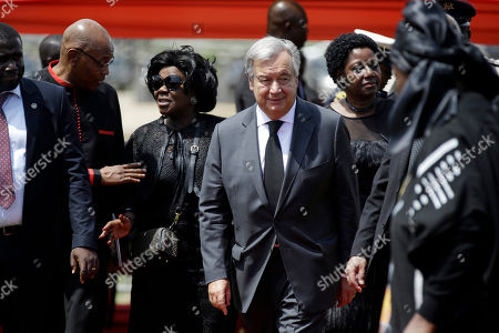 Current U.N. Secretary-General Antonio Guterres, centre, attends the funeral of former U.N. Secretary-General Kofi Annan, at a cemetery in Accra, Ghana . Former United Nations Secretary-General Kofi Annan was buried Thursday after a three-day funeral and ceremony