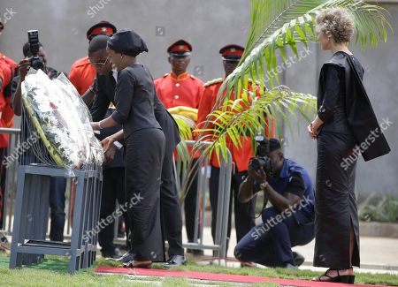 Kofi Annan's daughter, Ama Annan, left, Son, Kojo Annan, and Nina Cronstedt, lay a wreath during the funeral of their father, former U.N. Secretary-General Kofi Annan, at a cemetery in Accra, Ghana, . Former United Nations Secretary-General Kofi Annan was buried Thursday after a three-day funeral ceremony