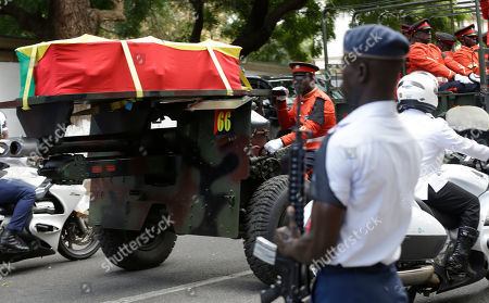 The coffin of late former U.N. Secretary-General Kofi Annan, wrapped in the flag of Ghana, is transported to the funeral cemetery in Accra, Ghana, . Former United Nations Secretary-General Kofi Annan will be buried Thursday after a three-day funeral and ceremony