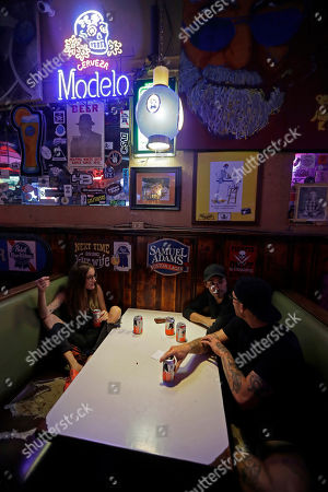 Kathryn Cloniger-Kirk, Michael Ussery, Steven Harrington. Kathryn Cloniger-Kirk, left, Michael Ussery, right, and Steven Harrington, back, chat as they relax at Barbary Coast bar in downtown Wilmington, N.C., as the Florence threatens the coast