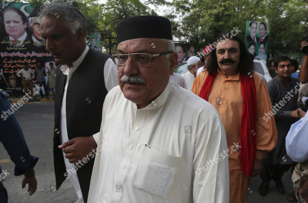 Pakistani politician Mian Iftikhar, center, arrives at a residence of Pakistan's former prime minister Nawaz Sharif to offer condolences for the death of Sharif's wife Kulsoom Nawaz, in Lahore, Pakistan, . Mourners have attended the funeral of the wife of Sharif in London, where she died at a hospital this week after months in critical condition. According to Sharif's family she will be buried in Lahore on Friday