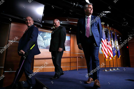 Kevin McCarthy, Steve Scalise, Ron Estes. House Majority Whip Steve Scalise, R-La., left, and Rep. Ron Estes, R-Kansas, walk off the stage as House Majority Leader Kevin McCarthy of Calif., turns to chat with reporters, after a news conference, in Washington