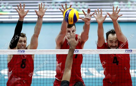 Egypt's captain Ahmed Abdelhay (his hand in the center) in action against Canada's Justin Duff (L), Canada's Graham Vigrass (C) and Canada's Nicholas Hoag (R) during the FIVB Men's World Championship match between Egypt and Canada, in Ruse, Bulgaria, 13 September 2018.