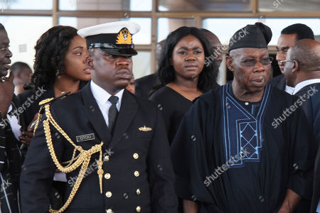 Former Nigeria President, Olusegun Obasanjo, right, leaves after the funeral service of former U.N. Secretary-General Kofi Annan, at the Accra International Conference Center in Ghana . Former United Nations Secretary-General Kofi Annan was buried Thursday after a three-day funeral and ceremony