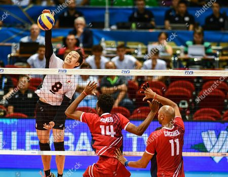 Japan's Masahiro Yanagida (L) and Dominican Felix Miguel Romero Perez (C) and Jose Miguel Caceres Gomez (R) in action during the FIVB Men's World Championship Pool A match between Dominican Republic and Japan at the Mandela Forum in Florence, Italy, 13 September 2018.