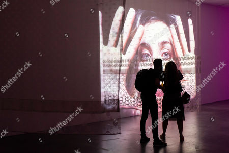 """Visitors look at the installation of Swiss artist Pipilotti Rist """"Show a Leg"""" during a Pop-Up-Event at the Migros Museum of Contemporary Art in Zurich, Switzerland, 13 September  2018."""