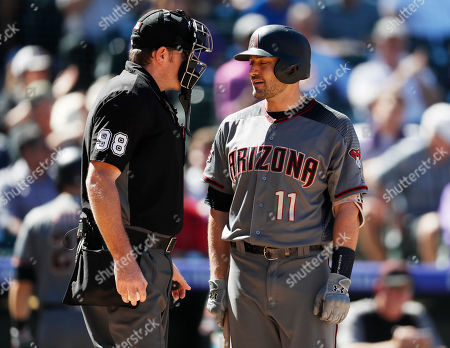 Chris Conroy, AJ Pollock, chris conroy, aj pollock. Arizona Diamondbacks' A.J. Pollock, right, confers with home plate umpire Chris Conroy after he called out Pollock on strikes to end the top of in the fourth inning of a baseball game against the Colorado Rockies, in Denver
