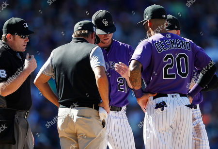 Chris conroy, Kyle Freeland, Ian Desmond, chris conroy, ian desmond, kyle freeland, keith duggar. As umpire Chris Conroy, left, observes, Colorado Rockies trainer Keith Duggar, second from left, checks the hand of starting pitcher Kyle Freeland while first baseman Ian Desmond looks on in the seventh inning of a baseball game against the Arizona Diamondbacks, in Denver. Freeland left the game after the conference