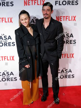 """Mexican actor Alberto Guerra, who stars in the Netflix series """"Ingobernable,"""" poses for photographers with his wife, actress Zuria Vega, at the red carpet event promoting another Netflix series, """"La Casa de Las Flores,"""" in Mexico City. """"Ingobernable"""" premieres its second season on September 14"""