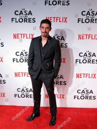 """Stock Image of Mexican actor Alberto Guerra, who stars in the Netflix series """"Ingobernable,"""" poses for photographers at the red carpet event promoting another Netflix series, """"La Casa de Las Flores,"""" in Mexico City. """"Ingobernable"""" premieres its second season on September 14"""