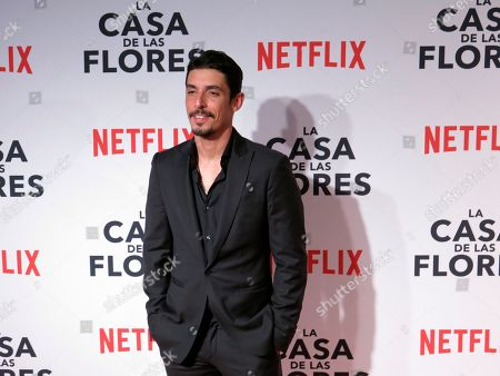 """Mexican actor Alberto Guerra, who stars in the Netflix series """"Ingobernable,"""" poses for photographers at the red carpet event promoting another Netflix series, """"La Casa de Las Flores,"""" in Mexico City. """"Ingobernable"""" premieres its second season on September 14"""