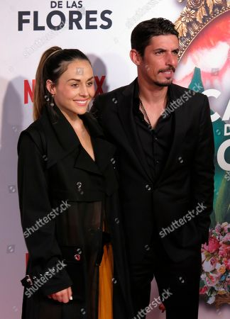 """Mexican actor Alberto Guerra, who stars in the Netflix series """"Ingobernable,"""" poses for photographers with his wife, actor Zuria Vega, at the red carpet event promoting another Netflix series, """"La Casa de Las Flores,"""" in Mexico City. """"Ingobernable"""" premieres its second season on September 14"""