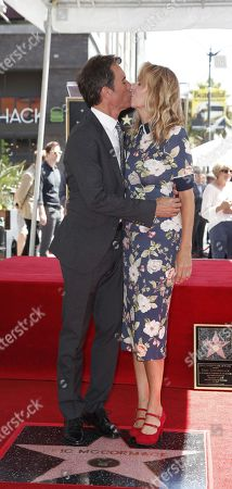 Canadian actor Eric McCormack (L) kisses his wie Janet Holden (R) during a ceremony honoring him with a star on the  Hollywood Walk of Fame in Hollywood, California, USA, 13 September 2018. McCormack received the 2,644th star in the Television category.