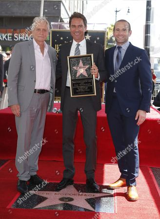 Canadian actor Eric McCormack (C) poses on his star with US actor Michael Douglas (L) and US producer Max Mutchnick (R) during a ceremony honoring him with a star on the  Hollywood Walk of Fame in Hollywood, California, USA, 13 September 2018. McCormack received the 2,644th star in the Television category.