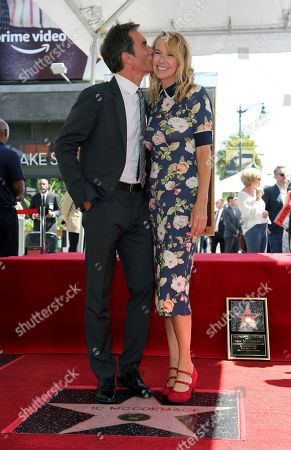 Eric McCormack, Janet Holden. Eric McCormack, left, kisses his wife Janet Holden after a ceremony honoring him with a star on the Hollywood Walk of Fame on Thursdasy, in Los Angeles