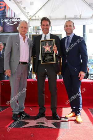 Michael Douglas, Eric McCormack, Max Mutchnick. Michael Douglas, from left, Eric McCormack and Max Mutchnick pose at a ceremony honoring McCormack with a star at the Hollywood Walk of Fame, in Los Angeles