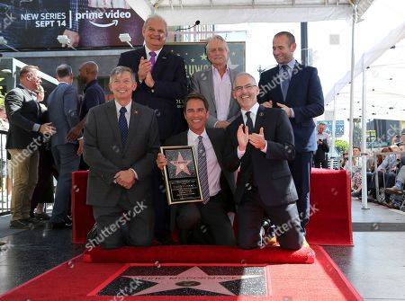 Leron Gubler, Jeff Zarrinnam, Michael Douglas, Eric McCormack, Max Mutchnick, Mitch O'Farrell. Leron Gubler, from left, Jeff Zarrinnam, Michael Douglas, Eric McCormack, Max Mutchnick and Mitch O'Farrell pose right after unveiling the 2644th star in the category of Television at the ceremony honoring Eric McCormack with a star at the Hollywood Walk of Fame, in Los Angeles