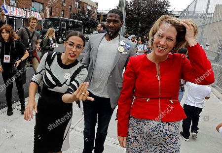 New York City congressional nominee Alexandria Ocasio-Cortez (L), Jumaane Williams running for New York State Lt. Governor (C) and Zephyr Teachout, candidate for New York State attorney, arrive to meet potential voters at Public School 019 in Corona, Queens, New York, USA, 13 September 2018. Today voters are casting ballots in the New York State Democratic Primary.