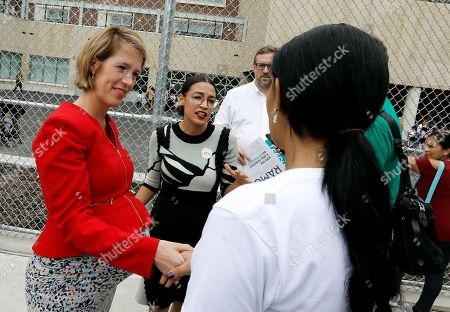 New York City congressional nominee Alexandria Ocasio-Cortez (C) and Zephyr Teachout, (L) candidate for New York State attorney meet potential voters at Public School 019 in Corona, Queens, New York, USA, 13 September 2018. Today voters are casting ballots in the New York State Democratic Primary.