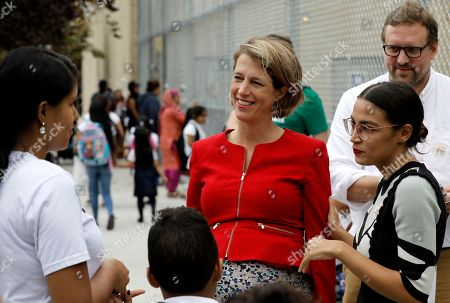 New York City congressional nominee Alexandria Ocasio-Cortez (R) and Zephyr Teachout, (C) candidate for New York State attorney meet potential voters at Public School 019 in Corona, Queens, New York, USA, 13 September 2018. Today voters are casting ballots in the New York State Democratic Primary.