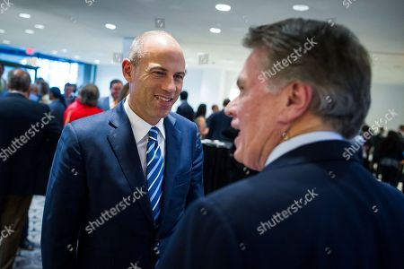 Attorney Michael Avenatti, left, arrives at the Economic Club of Washington's Milestone Celebration where Jeff Bezos, Amazon founder and CEO, will be talking, in Washington, . Bezos said Thursday that he is giving $2 billion to start the Bezos Day One Fund which will open preschools in low-income neighborhoods and give money to nonprofits that helps homeless families