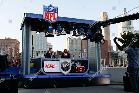 LaDainian Tomlinson, Dan Hellie. LaDainian Tomlinson, right, and Dan Hellie, left, perform during a pre-game program before an NFL football game between the Cincinnati Bengals and the Baltimore Ravens, in Cincinnati