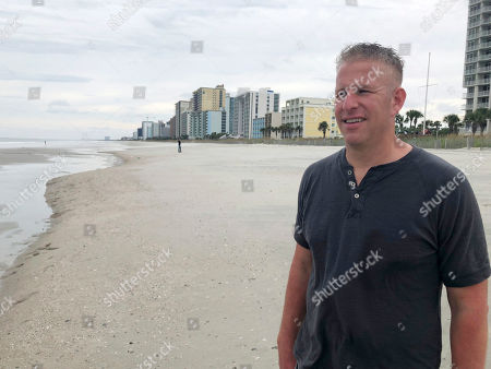 """Stock Photo of This image taken from video shows storm surge expert Hal Needham, in North Myrtle Beach, N.C. Florence's storm surge will probably be 7 to 11 feet above ground in parts of North Carolina, according to the National Hurricane Center. Even if a house is elevated 10 feet, with that kind of storm surge, """"there's a good chance there's going to be water inside of it,"""" Needham said"""